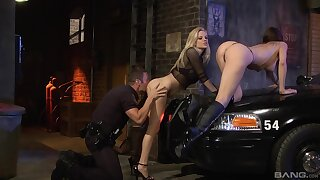 Fine babes shot at hard sex with a cop during one crazy threesome exposed to a back alley