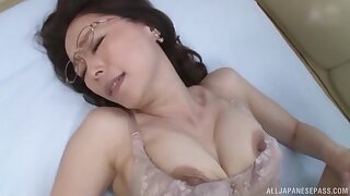 Asian grown-up opens her legs to be fucked by a stud in missionary