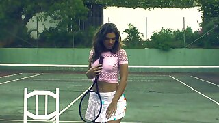 Beautiful solo brunette pleasuring her cunt on a tennis court